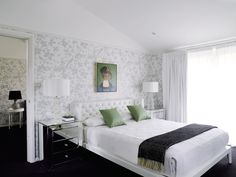 A beautifully designed Greg Natale room featuring our Florence Broadhurst 'Summer Garden' wallpaper in soft linen ink.