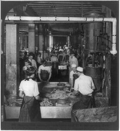Making link sausages--machines stuff 10 ft. per second, Swift & Co.'s Packing House, Chicago, U.S.A.