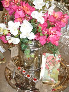 Decorate your Valentine table with pretty pink flowers in mercury glass.