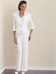Wedding pants suit - This is appropriate for a casual theme wedding. This is also appropriate for a beach, garden or even a civil wedding.  A non-traditional look for a cool , edgy bride . Bridal suits are not just for second time or older brides. First time brides can wear this too.