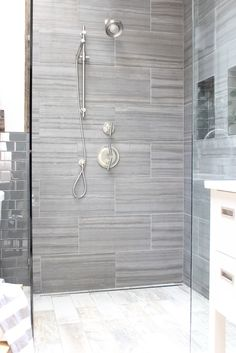design indulgence: BEFORE AND AFTER - shower tile here: http://www.flooranddecor.com/porcelain-tile/georgette-dark-porcelain-tile-100033968.html#prefn1=color&prefn2=size&prefv2=12in.+x+24in.&sz=37&prefv1=Gray&start=27 floor tile here: http://www.flooranddecor.com/porcelain-tile/canyon-timber-wood-plank-porcelain-tile-100010214.html#sz=60&start=33