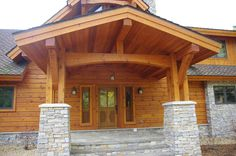A grand main entrance invites you to enter a  beautiful custom home. We enjoy building homes like this throughout the Vilas County area of Northern Wisconsin and Upper Michigan.