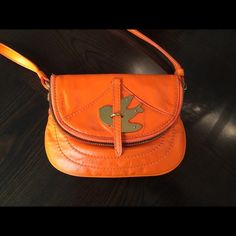 Marc Jacobs Petal To The Metal Crossbody Bag Beautiful Hermès orange Italian leather color, this little pursue is excellent for daily use or for traveling. Almost impossible to find at the stores (sold out) comes with authenticity card/care instructions and dust pouch. Brand new (never used) Marc by Marc Jacobs Bags Crossbody Bags