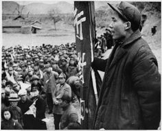 """Caption on back reads: """"Standing on a raised platform, Mao Tse-Tung, leader of China's Communists, addresses some of his followers.  In the north of China, he and his Communist armies control some eighty million people and thousands of square miles of territory, in defiance of the Kuomintang Government."""" Nov. 30, 1944"""