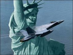 Liberty Rising, by Dru Blair The pilot of an F-18 Hornet turns to salute our Statue of Liberty as he executes a close pass. The F-18 Hornet soon will replace the venerable F-14 Tomcat as the Navy's premier front-line fighter. The Hornet is also the choice of the US Marine Corps and the Navy's Blue Angels demonstration team.