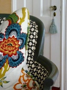 Pillow in Schumacher Celerie Kemble Hot House Flowers Spark and Betwixt on Chair