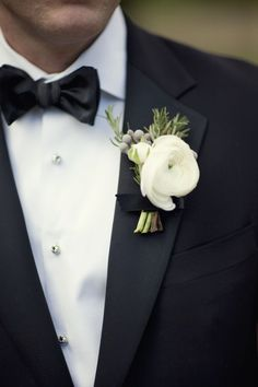 boutonnieres: white ranunculus, rosemary and green leaves wrapped in black ribbon with the stems showing. Ranunculus Boutonniere, Corsage And Boutonniere, Boutonnieres, White Boutonniere, Winter Wedding Flowers, Floral Wedding, Wedding Bouquets, Elegant Wedding, Groomsmen Boutonniere