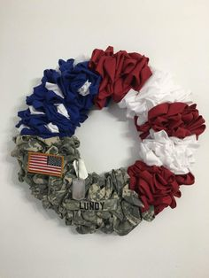DIY Army Wreath I have been wanting to make a military wreath for a while, I can't remember where I saw one at but I thought it was so cool that I wanted to make my own. Since the Army upgraded to OCP unifor… Patriotic Wreath, Patriotic Crafts, 4th Of July Wreath, Patriotic Decorations, Army Wreath, Military Wreath, Dog Wreath, Army Crafts, Military Crafts