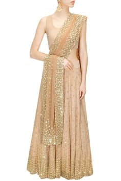 Buy Peach shimmer lehenga set by Astha Narang online in India at best price. Featuring a peach net kalidaar lehenga embellished with nakshi and sequins hand-embroidery. It is pa Ethnic Outfits, Indian Outfits, Western Dresses, Indian Dresses, Latest Designer Sarees, Designer Dresses, Salwar Kameez, Churidar, Desi Clothes