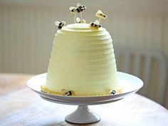 Banana honey flavored bee cake with instructions on how to make marzipan bees