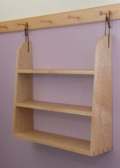 Shaker Style Shelving hung from pegs - adjustable.