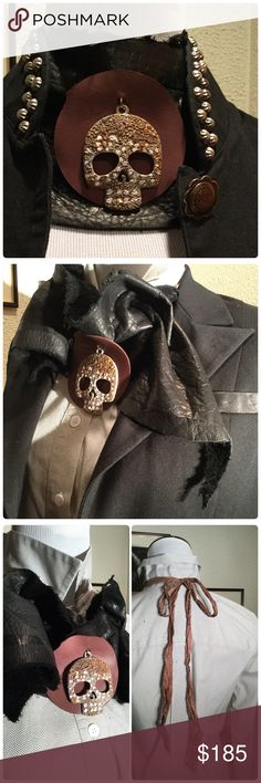 Leather Skull Collar Wrap Now this is a statement piece! I'd pair with a tank or tee or Ruch it like shown in photo with a classic button down and a blazer over it 💕💕 the skull  is made of an antique silver plated base metal alloy & hand painted back side is not painted. distressed and sealed w/a clear matte spray. The matte sealer protects the color and imparts a rustic look, super soft supple leather is tied and ruched with a silk sari ribbon. Feels fantastic on. Def for the bold bad…