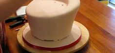 This video demonstrates how to make a topsy turvy cake. This is a very hard cake to make and requires some previous baking experience. He bakes a cake first and layers them using icing as a glue. He makes sure the cake is semi-frozen first before he starts carving it to be the base of the cake. After he is done carving, he covers the cake with icing. If you follow the rest of the steps in this video, you'll have a beautiful topsy turvy cake.