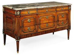 A LOUIS XVI ORMOLU-MOUNTED TULIPWOOD AND PARQUETRY COMMODE -  CIRCA 1785, STAMPED IN THE 19TH CENTURY BY 'CH. LAVAL'