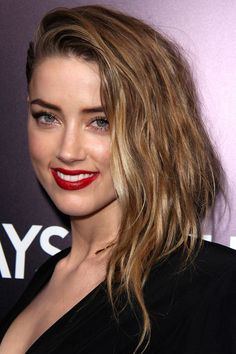 Amber Heard's textured, side-parted waves: http://beautyeditor.ca/2014/02/14/fake-an-undercut/