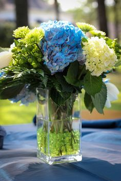 Interesting centerpieces option - crystals with flowers in glass container