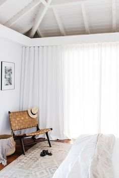 wood chair with woven seat and back in all white bedroom. / sfgirlbybay