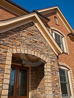 Luxury Model Home Exterior stone arch entrance by Anthony Berenyi, via Dreamstime