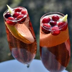 Delicious Christmas Bellinis made with fresh cranberries and pear!