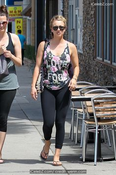 Kaley Cuoco Leaves a gym in Studio City with friends wearing a 'Love Fool' floral top http://icelebz.com/events/kaley_cuoco_leaves_a_gym_in_studio_city_with_friends_wearing_a_love_fool_floral_top/photo1.html