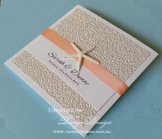 Coral beach wedding invitation with pebble paper enhancing the pocketfold design. A natural starfish embellishment feature on the front. Stunning for beach weddings, beach party, or any beach destination event. #seasideweddinginvitations #beachweddinginvitations #undertheseabirthday #coralwedding #beachwedding