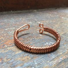 Copper Bracelet / Copper Bangle with woven design. by DerekMcqueen