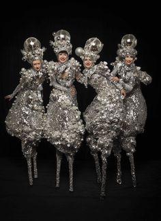 The Silver Belles - Stilt Walkers   London  UK #silver stilt walkers #gold stilt walkers #christmas entertainment