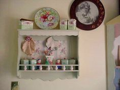 adorable shelf made even more so with paint and vintage wallpaper