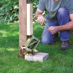 Remove a stubborn 90 x 90mm fence post without breaking a sweat. Secure a 90 x 45mm piece of timber vertically onto the post using six screws. Position a jack on a block and lift the post right out of the hole. | Handyman Magazine |