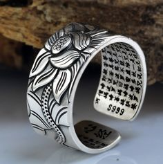 Do you know the Lotus of Buddha? The Lotus represents Purity and Faithfulness. Get your Lotus ring from Merch Ape! Mens Silver Jewelry, Mens Silver Necklace, Sterling Silver Necklaces, Silver Earrings, Silver Ring, Diamond Jewelry, 925 Silver, Silver Bracelets, Short Necklace