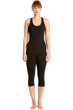 Black yoga top in 95% organic Fairtrade certified cotton, 5% elastane. Racer back design in stretch jersey. Length 59cm.