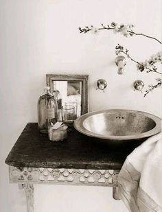 Pewter vessel sink and wall mount faucet