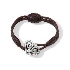 With hand-braiding and lacing, this cognac hued leather bracelet has a luxe bohemian flair and features heart-shaped hardware from our Alcazar Collection. #BrightonCollectibles