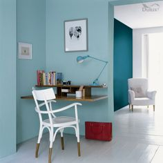 Dulux shades in Teal Tension and Blue Reflection create a tranquil room.
