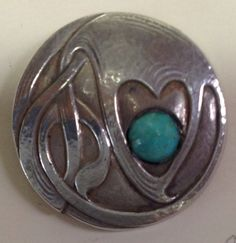 ca very early 20th century Liberty Cymric Silver Button with turquoise enamel. British.
