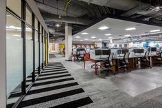 Workstations, Open floor, Ceiling Cloud, Exposed Ceiling, Carpet Keys, Interface, Concrete floors & Yellow Doors, Commercial Project - Cheatham Fletcher Scott
