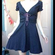 Free People Lace Up Soft Grey Flare Tie Back Dress Excellent condition. No stains. No rips / holes. No fading. Smoke free home. Stretchy. The fabric is 60% cotton and 40% polyester. Roosting gather is on the sides. Lace up tie up the front Lavender purple trim and ties. Casual. Basic. Fun with boots. Spring summer or winter. All seasons. Dresses C Free People Dresses Mini