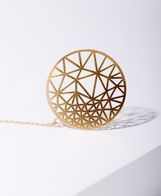 MIZYAN's gold plated rounded necklace, triangles, geomertic accessories