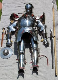 Plate armor and a spear