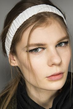 Fall 2015 beauty - Sam McKnight at Fendi fitted each model with a ruched leather headband, with loose strands falling around the face.