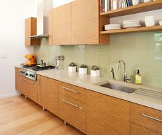 Large panels of glass used for the backsplash reflect the beautiful views outside. More kitchen backsplash ideas: http://www.bhg.com/kitchen/backsplash/kitchen-backsplash-photos/?socsrc=bhgpin062513glass=15