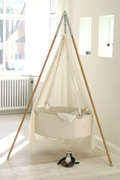 -one fabric hanging hammock...baby will have that antigravity feel...like being in the womb:ceeanne...from www.weebabystuff.com