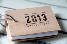 "2013 New Years Resolutions notepad - wood mini notepad (3"" x 2""). $15.00, via Etsy.  I like that you can keep this with you at all times.  A #stockingstuffer you (or your loved one) might actually use."