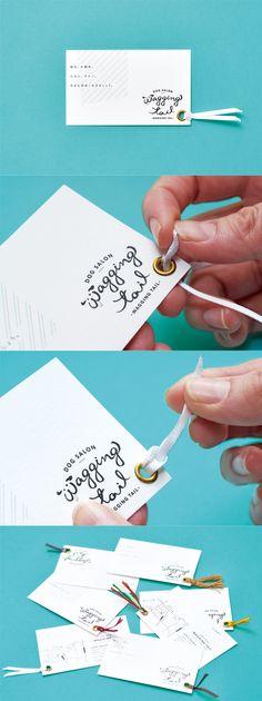 ドッグサロンwagging tail ブランディング 伊丹市にオープンしたドッグサロンのブランディング(ネーミング、ロゴ、ショップカード)を行いました。 尻尾のついたショップカードです。 Name Card Design, Tag Design, Graphic Design, Business Card Design, Business Cards, Cofee Shop, Member Card, Name Cards, Identity Design