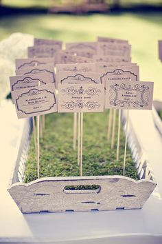 Great idea for place cards that incorporates moss! :: #wedding #escortcards #seating #moss