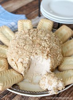 Cinnamon Bun Cheese Ball Recipe - a delicious dessert that's sure to impress! Very sweet & served with cookies for dipping.