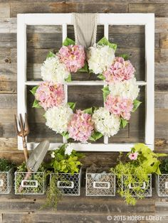 This simple wreath gives an easy upgrade to any space! Bunches of blooms keep this springtime wreath both simple and stunning. Attach flowers with many petals-- like the classic hydrangea-- to a metal form. Fill in spaces with greenery.