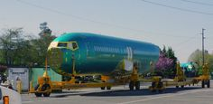 Fuselages of 737s on specialized transporters after shipment by rail