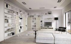 salon moderne blanc avec grande bibliothèque d'angle avec échelle