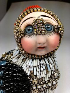 Besty Youngquist builds wonderful anthropomorphic sculptures with contemporary and antique beads from around the world and vintage porcelain doll parts and prosthetic glass eyes. All her things are extra unusual and unique. Must see! Click to visit Besty Youngquist website Click to get book about Beading